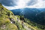 two mountain bikers on the way downhill, Slatnik, Istria, Slovenia