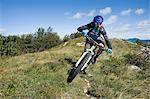 mountain biker on the way downhill, Vipava valley, Istria, Slovenia