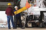 Maintenance supervisors preparing to load shielding onto utility truck