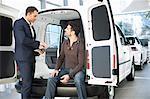 Indecisive customer and salesman in car dealership