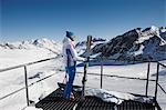 female skier looking down into ski area