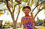Portrait of girl in scuba goggles in garden