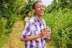 Teenage boys picking berries