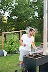 Man having grill in garden, Stockholm, Sweden