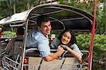 Smiling friends in rickshaw, Thailand