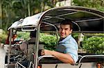 Young man in rickshaw, Thailand