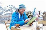 A man using digital tablet in ski destination.