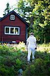 Woman walking near house