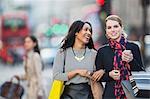 Women walking together down city street