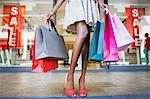 Woman carrying shopping bags in shopping mall