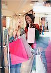 Women carrying shopping bags in store