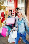 Women carrying shopping bags in shopping mall