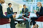Business people talking in meeting in office building