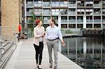 Couple walking along canal, East London, UK