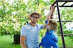 Portrait of mid adult couple in garden