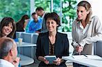 Business colleagues having informal meeting in office