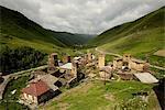 View of old ruined Svanetian towers in valley, Ushguli village, Svaneti, Georgia