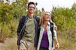 Couple enjoying walk in forest