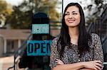 Portrait of sales assistant outside shop window