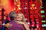 Woman and man embracing in nightclub