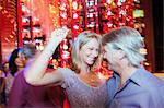 Mature couple dancing in night club