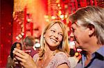 Mature couple smiling in nightclub