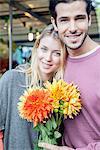 Couple with flower bouquet, portrait