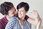 Couple holding up new house key
