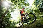 Man mountain biking in Isar footplains, Munich, Germany