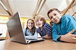 Three children with laptop