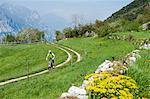 Mountainbiker riding along country path