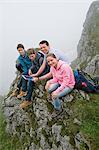 Father teenage kids using iPad in mountains