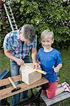 Teamwork boy man father son working