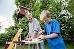 Grandfather grandson working together building