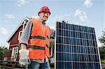 Close up portrait man holding solar panel