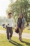 Full length of male high school students walking on schoolyard