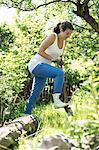 Mid adult woman gardening at yard