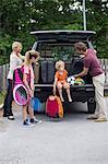 Family preparing for road trip