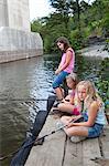 Girls fishing at river