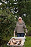 Woman in garden with wheel-barrow