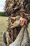 Hunter holding dead birds