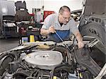 Mechanic repairs auto