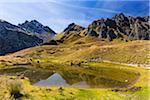 Mountains of Pizol Range Reflected in Pond in Autumn, Glarus Alps, Canton of St Gallen, Switzerland