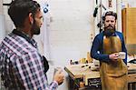 Two craftsmen chatting in pipe organ workshop