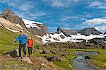 Hikers hiking at Dyrfjoll Mountain range, East Iceland, Iceland