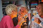 Older friends drinking wine
