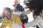 Friends enjoying snowball fight