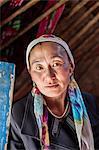 China, Xinjiang, Karakul lake. Kyrgyz woman inside her yurt (MR)