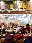 Hong Kong, China. Night view of street with restaurants