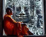 Cambodia, Siem Reap, Angkor Wat complex. Monks inside Bayon temple (MR)